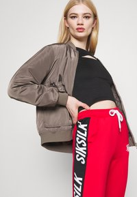 SIKSILK - CHASER TRACK PANT - Tracksuit bottoms - red - 3