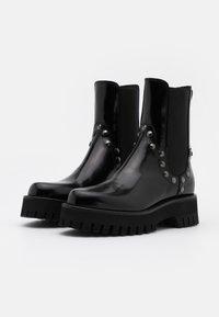 Casadei - Kotníkové boty na platformě - brushed nero - 2