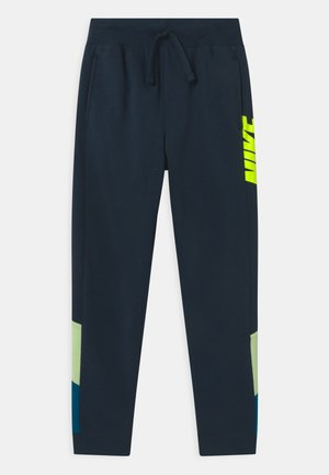 CORE AMPLIFY  - Tracksuit bottoms - deep ocean/light liquid lime