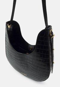 Coccinelle - BAGATELLE CROCO SHINY SOFT - Handbag - noir - 5