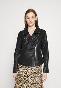 NA-KD - SHORT BACK BIKER JACKET - Leather jacket - black - 0
