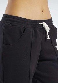 Reebok - PANT - Teplákové kalhoty - black - 4