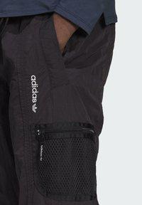adidas Originals - ADV Woven PANTS ADVENTURE ORIGINALS REGULAR TRACK - Tracksuit bottoms - black - 3