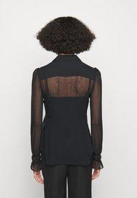 Victoria Beckham - FRILL DETAIL BLOUSE - Button-down blouse - black - 2