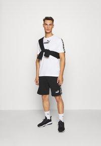 Puma - AMPLIFIED TEE - Print T-shirt - white - 1
