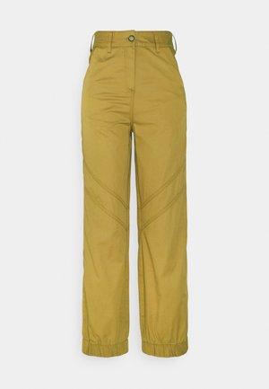 KARO - Trousers - golden beige