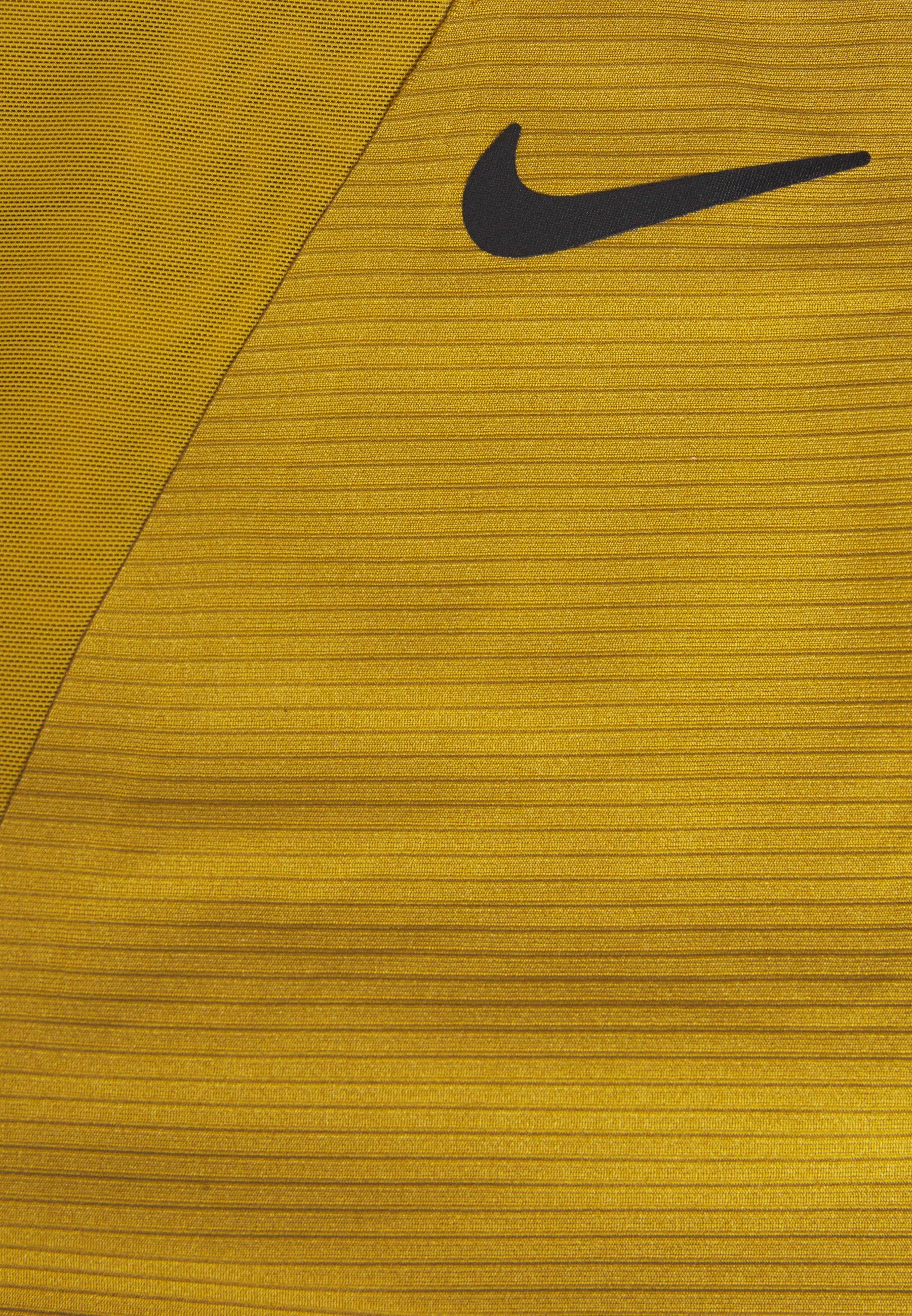 Nike Performance MARIA DRESS - Vestido de deporte - ochre/black NvsfJ