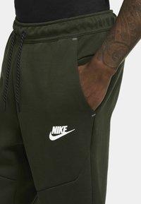 Nike Sportswear - Tracksuit bottoms - sequoia/black - 2