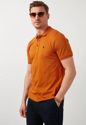Poloshirt - snuff colored