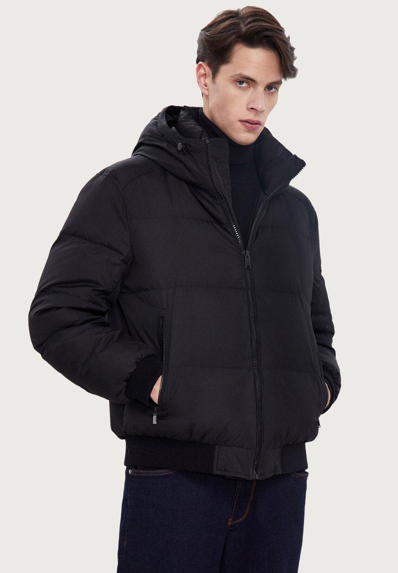 Finn Flare - Down jacket - black