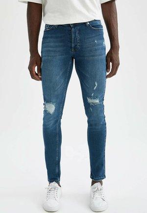 SLIM FIT JEANS - Slim fit jeans - green