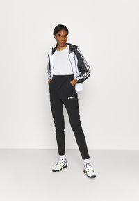 adidas Performance - STRIPES WINDBREAKER - Outdoor jacket - white/black - 1