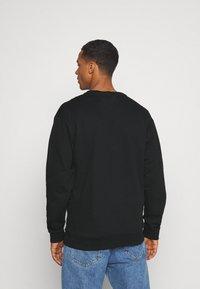 RETHINK Status - CREWNECK UNISEX - Sweatshirt - black - 2