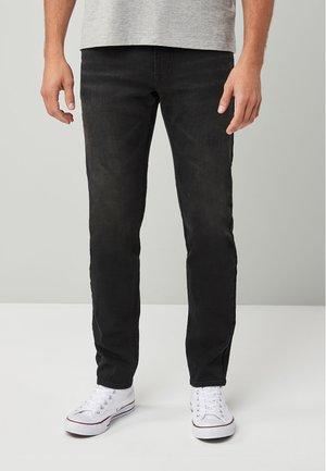 ULTRA FLEX - Slim fit jeans - black