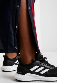 adidas Performance - SNAP - Tracksuit bottoms - dark blue - 3