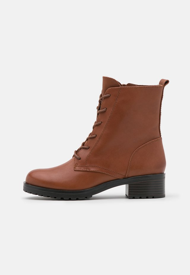 LEGENIA - Lace-up ankle boots - brown
