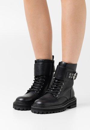 ANFIBIO DETTAGLIO FIBBIA - Lace-up ankle boots - nero