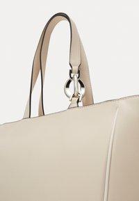 Calvin Klein - CHAIN SHOPPER - Handbag - beige - 3