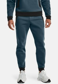 Under Armour - Tracksuit bottoms - blue - 0