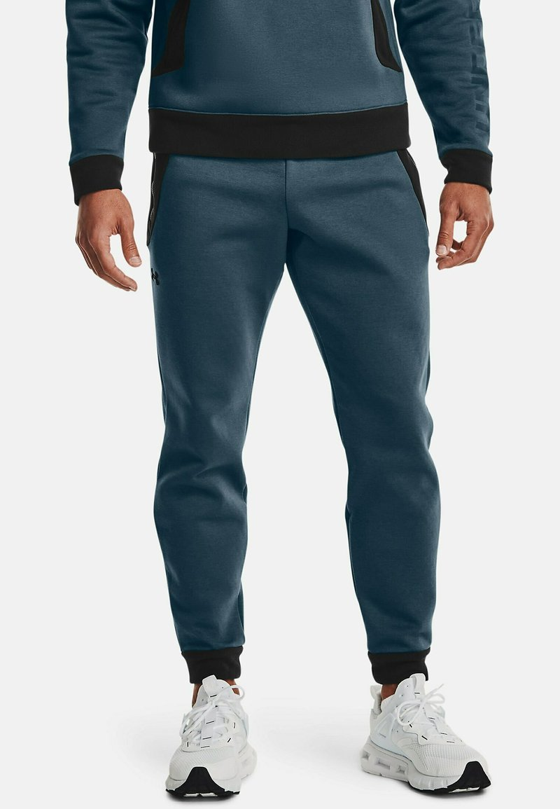 Under Armour - Tracksuit bottoms - blue