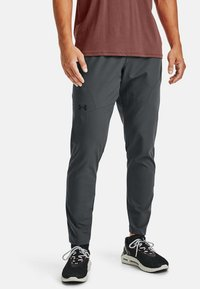 Under Armour - Tracksuit bottoms - pitch gray - 0