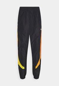 SPRAY UNISEX - Pantalon de survêtement - black