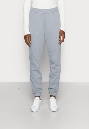 AUGUSTA LOOSE PANTS - Tracksuit bottoms - tradewinds