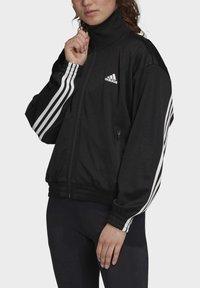 adidas Performance - MUST HAVES TRACK TOP - Training jacket - black - 4