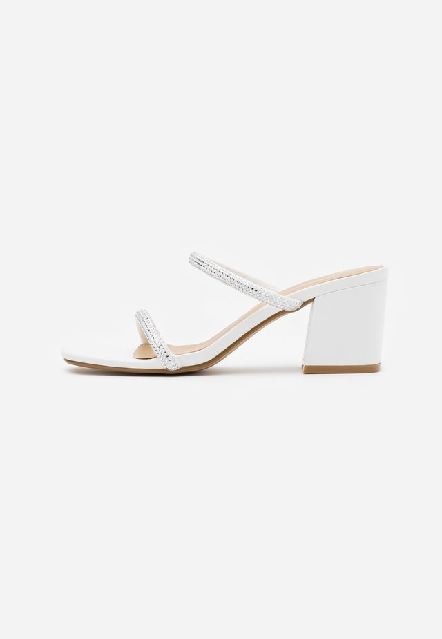CARLY - Heeled mules - white