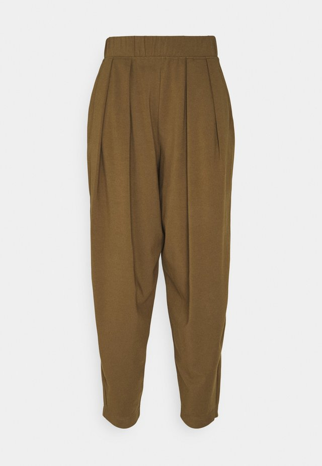 PIERA - Pantalon de survêtement - gold grun braun