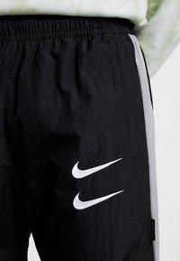 Nike Sportswear - Träningsbyxor - black/particle grey/white - 5