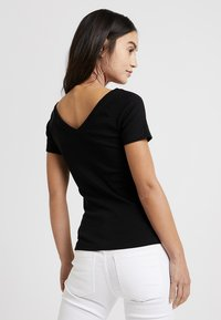 ONLY Petite - ONYLABELLA V NECK - Basic T-shirt - black - 2