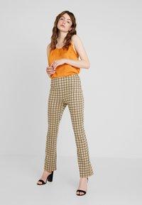 Vila - VIDIGAN FLARE PANT - Trousers - golden rod - 1