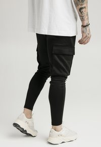SIKSILK - ATHLETE CARGO PANTS - Cargo trousers - black
