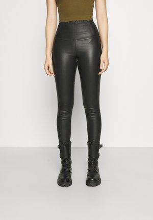 CORA - Leggings - Trousers - black