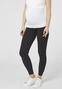 MAMALICIOUS - MLTIA JEANNE - Leggings - Trousers - black - 0