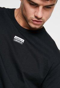 adidas Originals - REVEAL YOUR VOICE TEE - Basic T-shirt - black - 4
