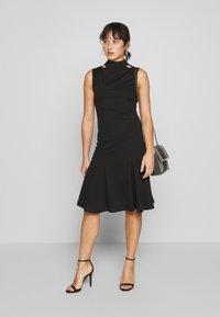 Lost Ink Petite - SLEEVELESS FISHTAIL BODYCON DRESS - Jersey dress - black - 1