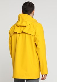 Helly Hansen - MOSS RAIN COAT - Waterproof jacket - essential yellow - 2