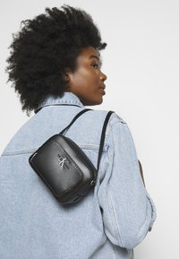 Calvin Klein Jeans - CAMERA BAG - Across body bag - black - 0