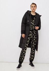 Liu Jo Jeans - LONG HOODED - Winter coat - black - 1
