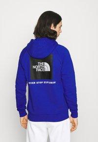 The North Face - RAGLAN HOODIE - Hoodie - blue - 2