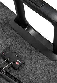Eastpak - TRANVERZ - Wheeled suitcase - black denim - 4