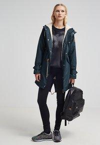Derbe - TRAVEL COZY FRIESE - Waterproof jacket - navy - 1