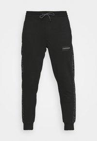Calvin Klein - REFLECTIVE PRINT - Pantaloni sportivi - black - 3