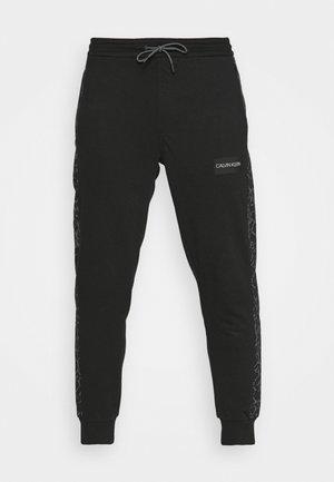 REFLECTIVE PRINT - Tracksuit bottoms - black