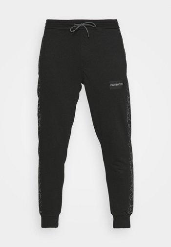 REFLECTIVE PRINT - Pantaloni sportivi - black