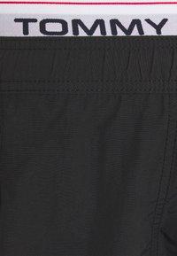 Tommy Hilfiger - LOGOLINE MEDIUM DRAWSTRING - Swimming shorts - black - 4