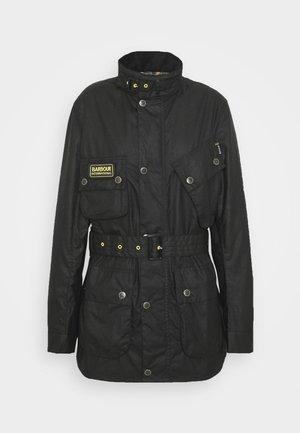 SLIM INTERNATIONAL WAX JACKET - Lehká bunda - black
