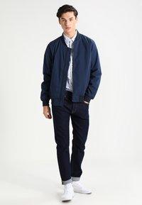 Carhartt WIP - KLONDIKE MILLS - Straight leg jeans - blue rinsed - 1